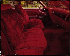 """View of interior of a 1976 Buick car. Label on sleeve: """"General Motors, Buick interior, 1976."""" Courtesy of the National Automotive History Collection, Detroit Public Library"""