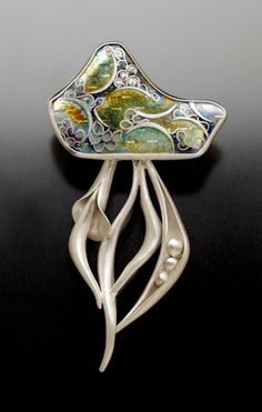 """Seeds  Anticlastic constructed shell formed Sterling silver mounting.   Vitreous high fired Cloisonne enamel over embossed fine silver.    3""""  Pin back: sterling silver."""