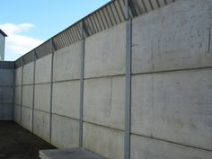 Concrete panels are ideal for use as precast concrete cladding as they are prestressed under factory controlled conditions to ensure quality and strength. Concrete Cladding, Precast Concrete Panels, Concrete Walls, Goat House, Interlocking Bricks, Steel Frame, Beams, Shelter, Mill Farm
