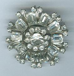 Vintage Austrian crystal rhinestone brooch--also is a great counterpoint to jeans and a blazer. Go big!!!!