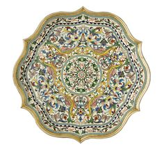 A SILVER-GILT AND CLOISONNÉ ENAMEL TRAY, IVAN SALTYKOV, MOSCOW, 1899-1908      shaped circular, decorated with shaded exotic birds and leafy scrolls on a cream-coloured ground, turquoise dot borders, 84 standard  diameter: 25.5cm, 10in. Click to enlarge. Source: http://www.sothebys.com/en/auctions/ecatalogue/2011/russian-works-of-art-faberg-and-icons/lot.551.lotnum.html