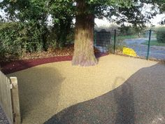 We installed different colours of resin bound rubber mulch to create this eye-catching area!