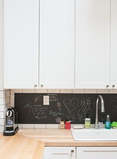 Chalkboard Paint in the Kitchen -- for the little bit of wall at the end of each counter where there are stools in plan # 6