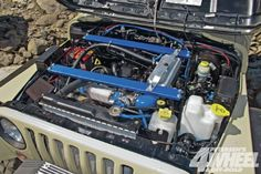 Check out a boosted 1998 Jeep Wrangler TJ that is stretched and turbocharged thanks to a Garrett turbo. See how this Jeep has plenty of power and suspension to tackle all the trails!