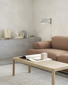 Modern and simple living room interior inspiration from Muuto: The Ambit Wall Lamp is designed with a quiet, modern expression and subtle details. Alter the expression of the Ambit Wall Lamp to your personal need through its rotating arm and head, bringing a refined light to any bedroom, kitchen or hallway.