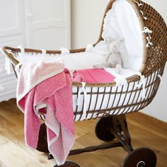 Love the basket esp the wheels!  And cute blanket from layla grayce