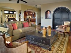 Mediterranean...  This warm living room exudes true Mediterranean-inspired elegance through its structure and decor. With dramatic interior architectural elements, the living room design is kept simple yet refined with a touch of Old World Spanish flair.