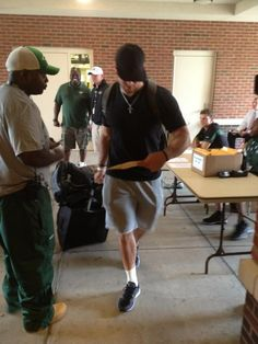 Tebow getting his room assignment (July 26, 2012)