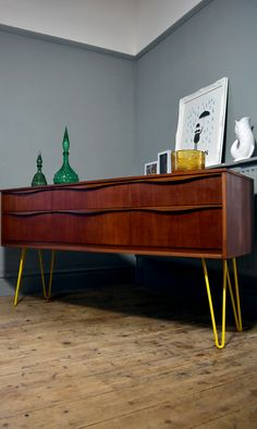 Mid Century Austinsuite Sideboard Sitting on Yellow Hairpin Legs.   https://www.facebook.com/VibeInteriorStyling/