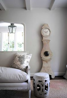 Timeless Swedish Style - mora clock and soft comfy couch.