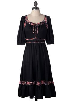 Remember the dresses, similar in style, that used 2-3 different kinds of material, but in the same colors?