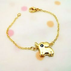 Check out this item in my Etsy shop https://www.etsy.com/listing/194176183/gold-plated-cute-elephant-bracelettiny