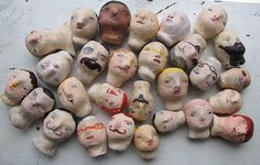a collection of painted heads