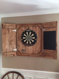 DIY Dart Board Case - put chalkboard and chalk holder on one side, dart holder on other, and corks as dart backboard. Also, put a design on wood (wood burning?) so it's decor when closed. #OneBoardWoodworkingProjects