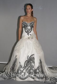Brides.com: St. Pucchi - 2013. Gown by St. Pucchi  See more St. Pucchi wedding dresses in our gallery.