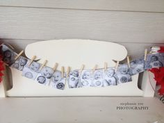 Project Nursery - Photo Clothesline of Baby Pictures