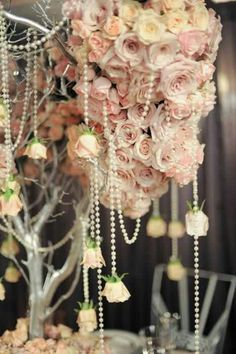 hanging roses on strands of pearls