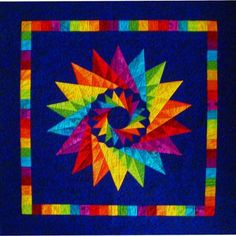 This Mariner's Compass Quilt is from a pattern by Judy Mathieson. The name of the pattern is Costa Rican Cartwheel. It's in both a book of Judy's and a