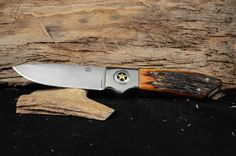 """Overall 10 1/4"""" with a 4 3/4"""" blade.  Red dyed jibbed camel bone handle with mirror finish.  Made with 440C steel"""