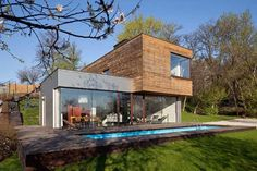 Clean lines, beautiful material, contemporary, spacious and lots of light! When am I gonna build a house like this!