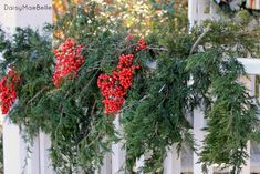 Love the berries mixed in witrh the pine boughs @ DaisyMaeBelle