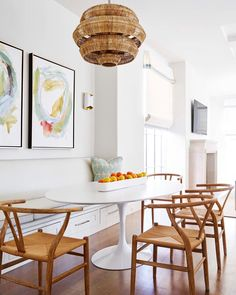 white tulip table with wishbone chairs | long white trough sold at blue print | custom bench seating for breakfast nook | light and bright kitchen | design by jenkins interiors |