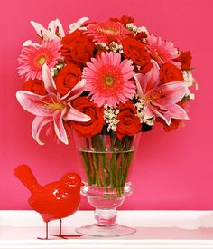 SCARLET Roses, Alstromerias, Gerberas, Lilium & Statice Tickle her pink with this stunning bouquet of roses, gerberas and lilies! Rose Bouquet, Spring Flowers, Scarlet, Glass Vase, Roses, Pink, Bouquet Of Roses, Rose, Scarlet Witch