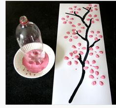 "KELS FA 1.3 Toddler and Preschooler -- This could be a fun medium to paint with for toddlers and preschoolers! ""Cherry blossom art made from soda bottle. CA.p4.13a- Uses a variety of materials to create art The child is using a empty bottle to dip in paint and make the flower blossoms."
