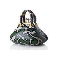http://www.polyvore.com/hand_painted_ceramic_handbag_cookie/thing?id=11861507