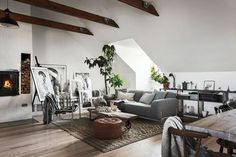 Scandinavian Attic Apartment Filled With Art