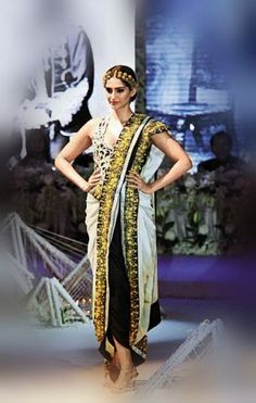 Sonam Kapoor walks for Anamika khanna in a Dhoti style saree drape outfit
