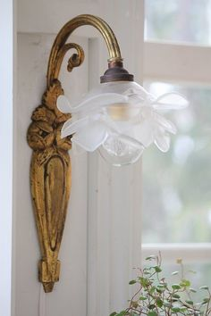 french antique bronze sconce and frosted glass rose lamp shade