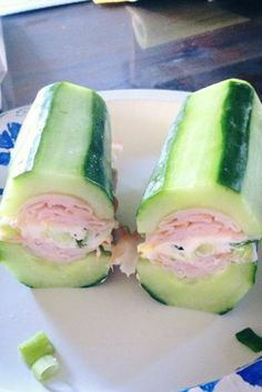 Sandwich with cucumber instead of bread. That's a LOT of cucumber, but it might be worth a try.
