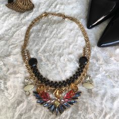 Unique statement necklace Very unique and funky statement necklace perfect for a night out. It has multicolored jeweled accents so it will go with most outfits or liven up a plain black or white top. The brand is Baublebar. In great condition. Only worn twice.   Bundle & Save: 20% off 2+ items!   No trades / selling off Posh.  ✔️ Reasonable offers always welcome. Baublebar Jewelry Necklaces