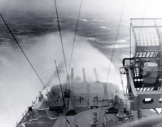 80-G-342732: USS Indiana (BB-58). Taking water over the bow, while steaming through a typhoon in the Okinawa area, circa 5 June 1945. Official U.S. Navy Photograph, now in the collections of the National Archives.