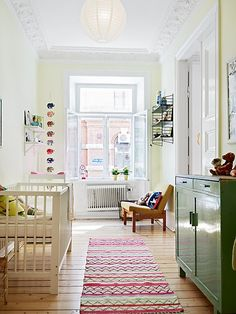 Neutral with splashes of bright color, love for a nursery/kids room
