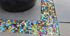 colored glass Instead of gravel in the garden or patio….Marbles!