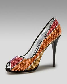 Love this Giuseppe Zanotti Crystal Pump ...Zanotti took a black suede pump and added gorgeous Swarovski crystal stripes... the result is dazzling!