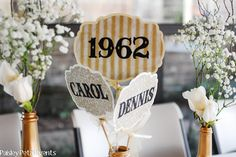50th anniversary party ideas on a budget | Favors included a bag of various gold chocolates and were tied with a ...