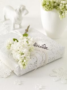 White paper packaging; use paper flowers for top rather than real