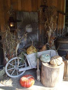 Primitive Fall Porch...pumpkins & corn stalks.