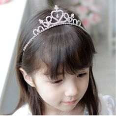 The #crown area is locate at the top of the #headband, it is very easy to wear without the help of pins. Unlike the plastic one, our tiaras are metal base with rhinestones decoration. This tiara look great on our little #girls!