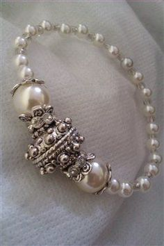 Gorgeous Pearl and silver bracelet - Beading Daily. Would love to make this for my many nieces someday.