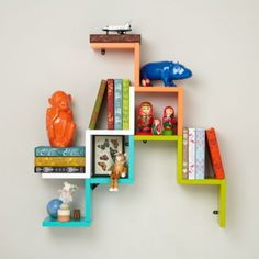 We tried making a shelf shaped like a paper crane.  But it was too hard to fold pine wood and iron, so we went with this simple zigzag shape instead.  Plus, it's pretty hard to store things on a crane. Details, details Nod exclusive Mix and match multiple shelves to create your own wall shelf display Great way to add a pop of color to any room in the house Each shelf holds up to 50 lbs.