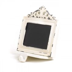 This chalkboard stocking holder looks to be made antique on purpose and will look stylish holding your holiday stockings.