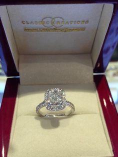 Gorgeous diamond engagement ring with halo and pave diamond band #diamondhalorings