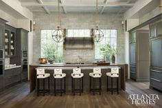 Luxury Kitchen, counter stools, coffered ceiling, stone, marble, brass, warm and cool colors