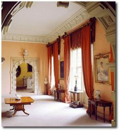 ORANGE DRAPERIES. NOTE GOLDEN WALL THROUGH DOOR        Sudbury Hall, Derbyshire (above) 1969 interior by John Fowler