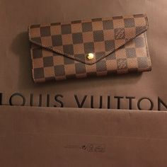💯 Authentic Louis Vuitton Josephine Ebene Wallet Mint condition Louis Vuitton Josephine damier ebene wallet. I have two ebene wallets and don't use this one so it's up for sale. Beautiful and classy Louis wallet. No trades, need to sell. Price includes wallet only. Listed price is starting price for negotiations. Thanks for looking! Louis Vuitton Bags Wallets