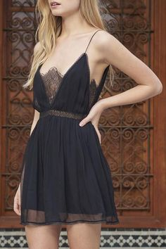 Mini dress with delicate lace details. Cinched waist with tie closure at back.